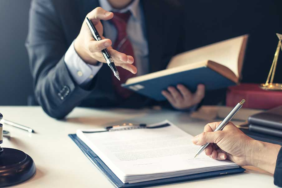 Businessman and Lawyer Discuss the Contract Document
