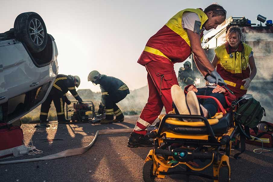 on the car crash traffic accident scene paramedics