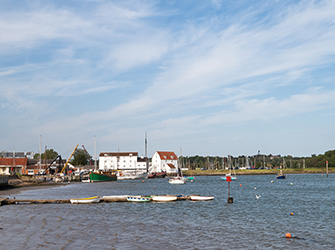 River Deben with moored boats and tide mill of Woodbridge, Suffolk, East Anglia, England, Great-Britain