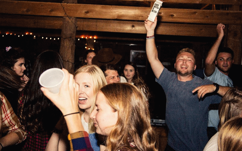 Young boys and girls having fun in a college party.