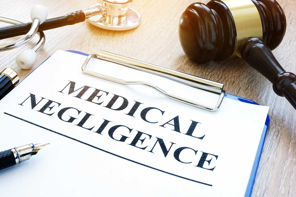 about medical negligence on a table.